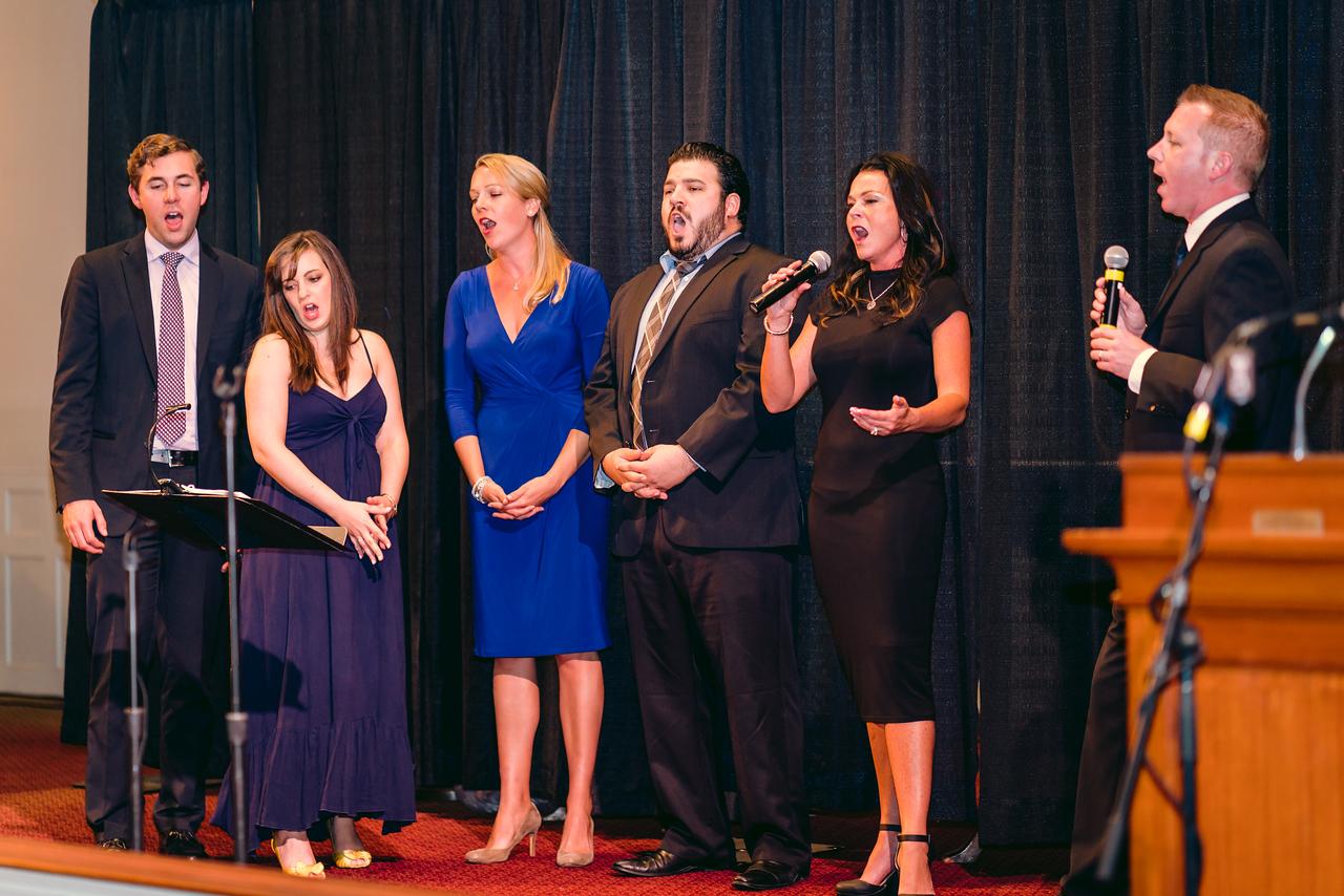 NEMPAC Singers, Sharon Z and Steve McNulty sing the finale