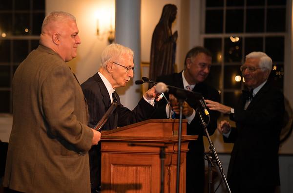 Albert Natale accepts award from Saint Joseph's Society