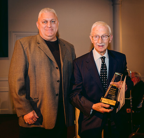St. Joseph Society President Peter Bagarella presents Musical Achievement Award to Al Natale
