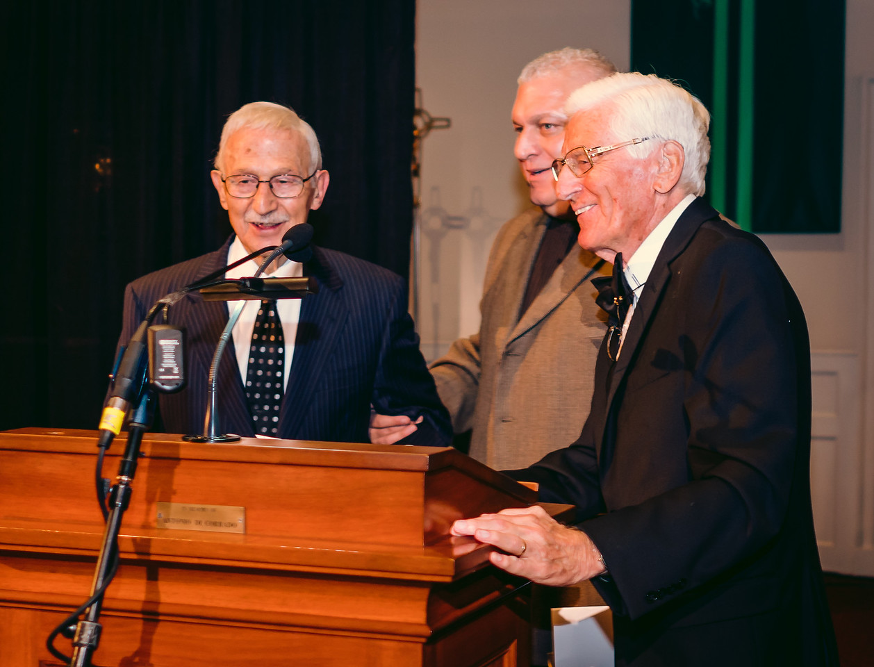 Albert Natale (left) is honored by St. Joseph Society President Peter Bagarella and Host Angelo Polcari