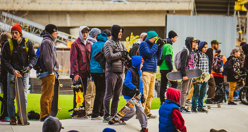Anxious skateboarders waiting for the park to open