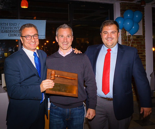 Former NEWNC President Stephen Passacantilli is honored by City Councilor Sal LaMattina and current NEWNC President Philip Frattaroli