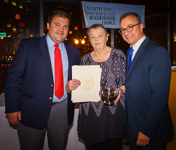 Founding NEWNC member Maryann D'Amato is honored by City Councilor Sal LaMattina and current NEWNC President Philip Frattaroli