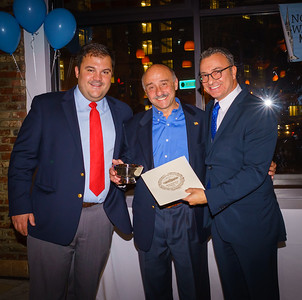 Founding NEWNC member Tom Arcadipane is honored by City Councilor Sal LaMattina and current NEWNC President Philip Frattaroli