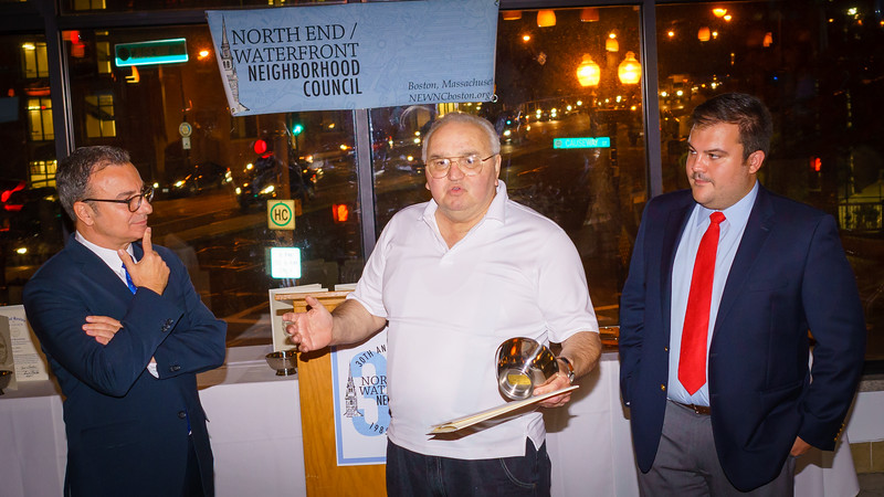 Founding NEWNC member Johnny 'Shoes' Cammarata is honored by City Councilor Sal LaMattina and current NEWNC President Philip Frattaroli