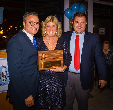 Former NEWNC President Donna Freni is honored by City Councilor Sal LaMattina and current NEWNC President Philip Frattaroli