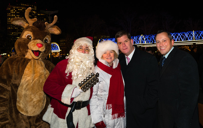 In front of the trellis, (L-R) Rudolf, Santa Claus, FOCCP President Joanne Hayes-Rines, Boston Mayor Marty Walsh and State Rep. Aaron MIchlewitz