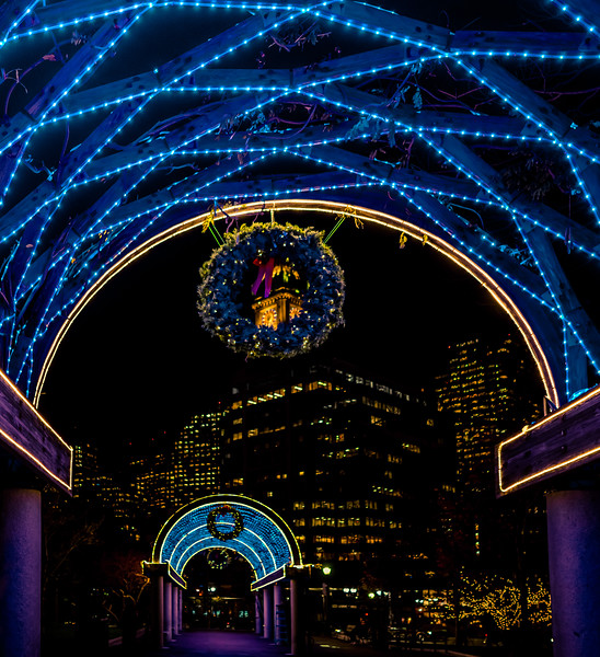 Holiday decorated trellis at Christopher Columbus Park