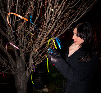 Cara Leonard from Hawaii ties a ribbon on the Wishing Tree, an ancient tradition