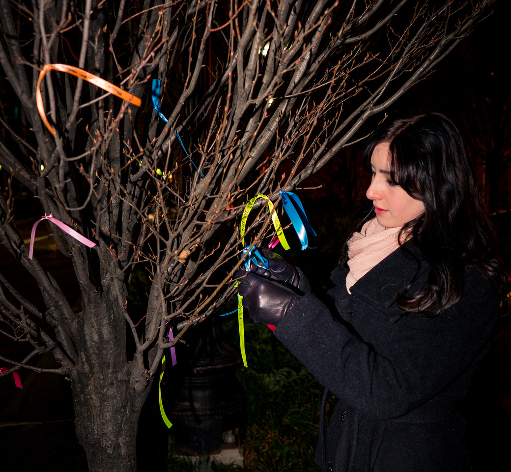 Cara Leonard from Hawaii places ties a ribbon on the Wishing Tree, an ancient tradition