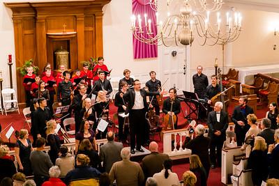 Conductor Kristo Kondakci invites the audience to sing for the Hallelujah Chorus encore