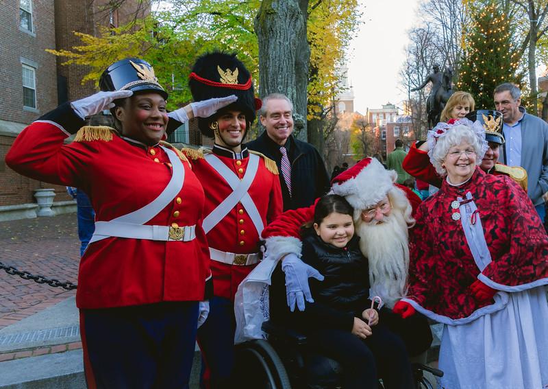 Santa's helpers greet kids on the Prado