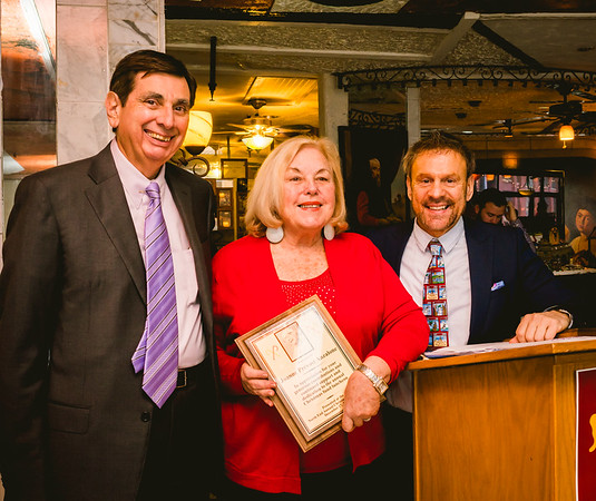 Joanne Prevost Anzalone is presented the Community Service Award by Ted Tomosone and Jim Luisi