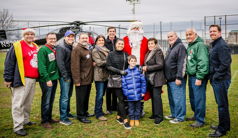 Group Photo of North End Christmas Parade sponors including the Palotta family, Taste of the North End Donato Frattaroli, NEAA, Councilor Sal LaMattina and Rep. Aaron Michlewitz