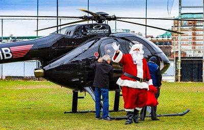 Santa arrives by helicopter at the North End park