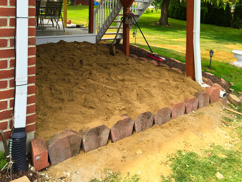 Adding sand to build up the area