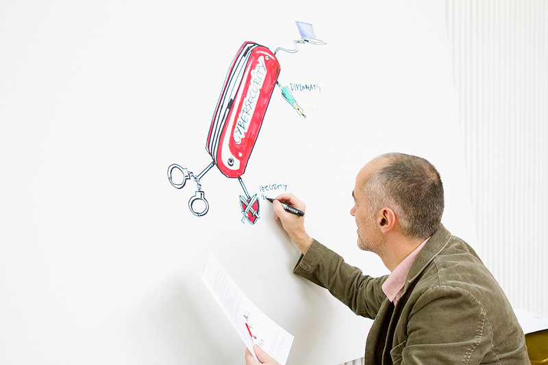 Diplo's illustrator Vladimir Veljasevic working on the Cybersecurity Toolbox (Swiss knife)