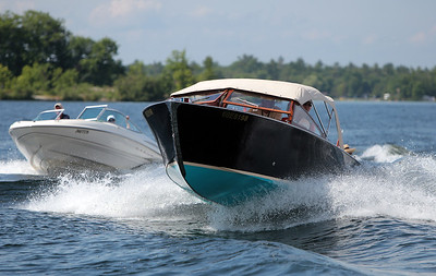 Aqua Velvet, owned by Linda and Rich Hughes, jumps through the wake of the group touring Gloucester Pool Wednesday. Aqua Velvet is a fully restored 1968 22' Greavette.