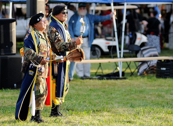 Don Knight | The Herald Bulletin<br /> From left, Vietnam Veterans and Cherokee Nation Color Guard members John Stayathome and Juan Rodriguez participate in a warrior dance during the Andersontown Powwow at Athletic Park on Saturday.