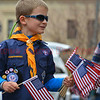 A cub scout hands out American Flags to parade observers before the start of the Veterans Day Parade in downtown Colorado Springs, Colorado. November 5, 2016