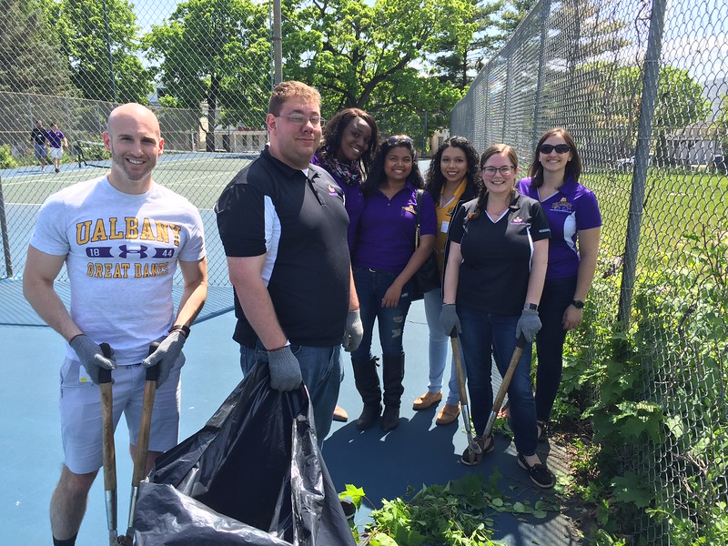 Staff from UAlbany's Division of Student Affairs volunteered at four different City of Albany sites for Confab 2016. (Photo by Mike Christakis)