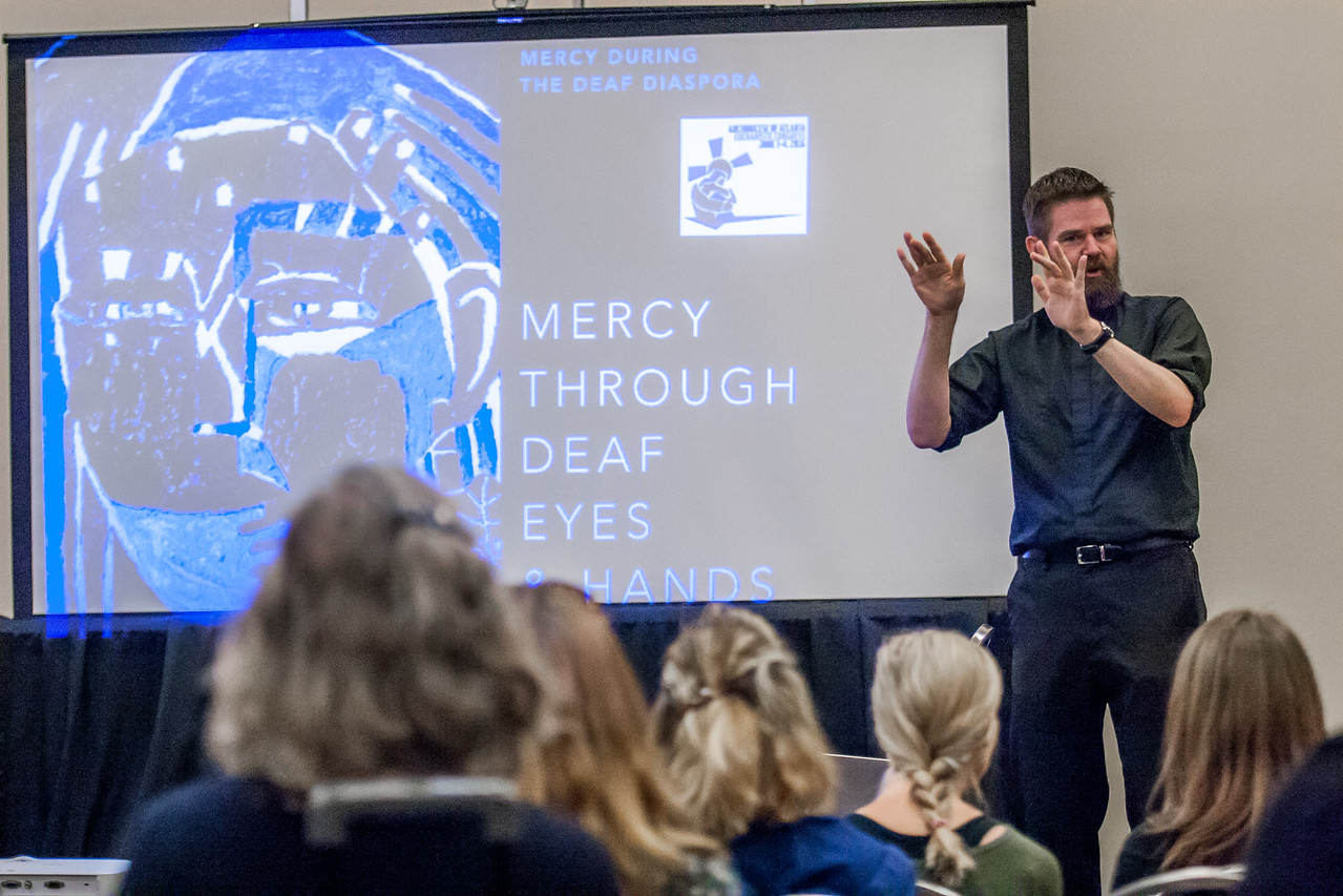Father Christopher Klusman, of Milwaukee, Wisconsin, was the presenter for the American Sign Language track at the 2016 Eucharistic Congress June 4. One of a small number of profoundly deaf priests worldwide, Father Klusman shared a message of mercy. Photo By Thomas Spink