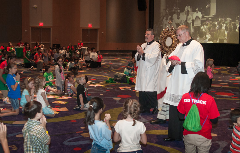 Deacon Thomas McGivney, of St. Thomas Aquinas Church, Alpharetta, standing left, Deacon Thomas Ryan, of St. Clare of Assisi Mission, Acworth, standing right, interact with the children in the Adore! track at the Eucharistic Congress June 4. Some 400 children, from ages 5 to 11, spent the day doing crafts, enjoying music and skits, praying and learning about mercy. Photo By Thomas Spink