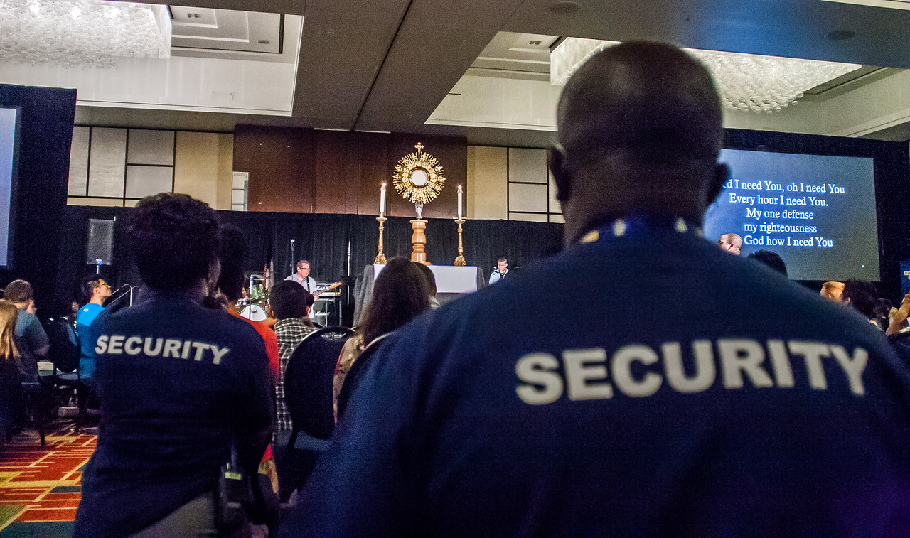 The close of the REVIVE session included time in prayer and adoration before the Blessed Sacrament. Eucharistic Congress security people were on hand as a precaution at the Marriott Gateway Hotel, where the track was held.  Photo By Thomas Spink