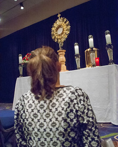 A woman takes time to stop in the adoration chapel for a moment of prayer before the Blessed Sacrament. Photo By Thomas Spink