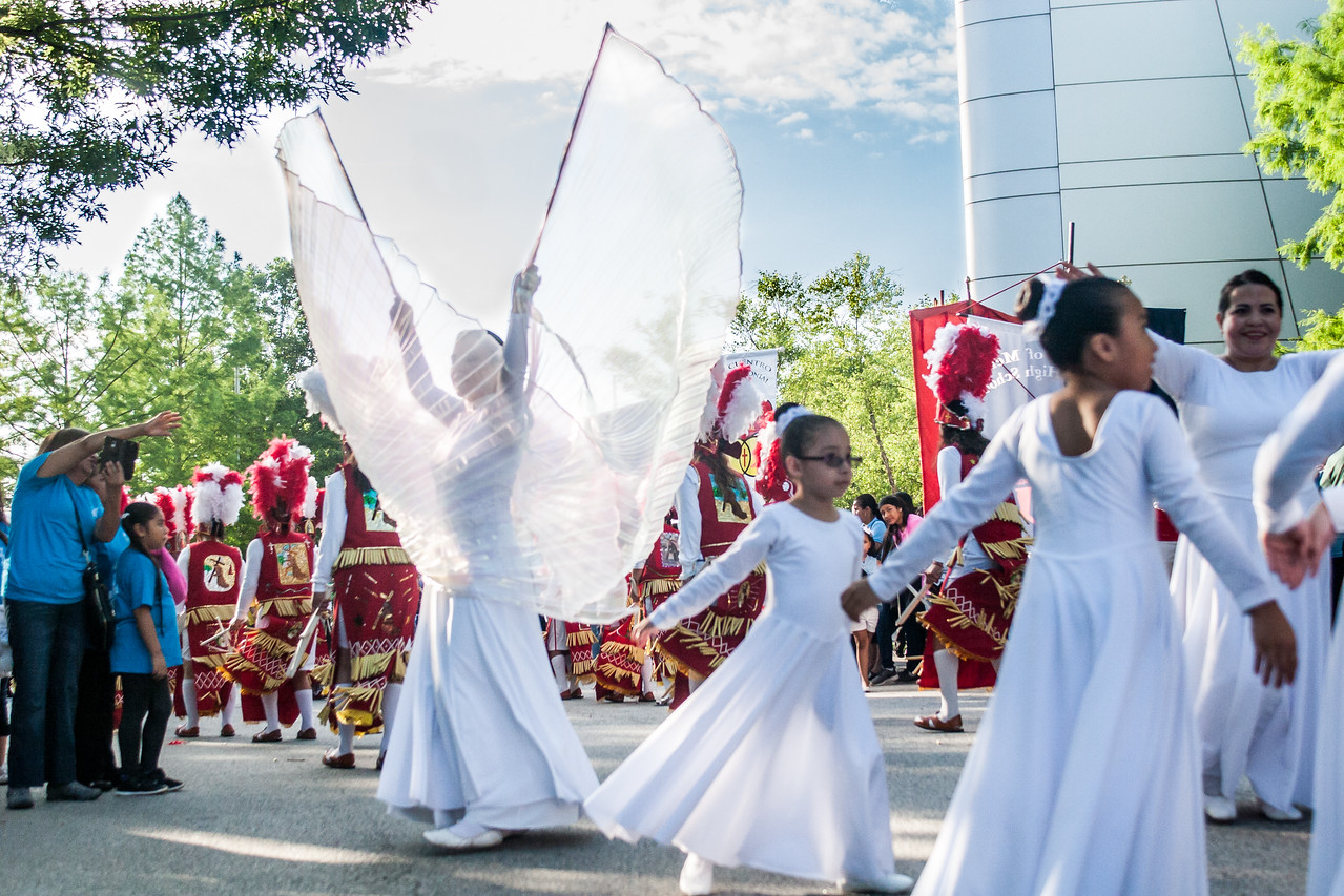Twenty-year-old Jennifer Mondragon, left, depicts a graceful angel as she performs with her younger dance companions from St. Patrick Church, Norcross. Photo By Thomas Spink