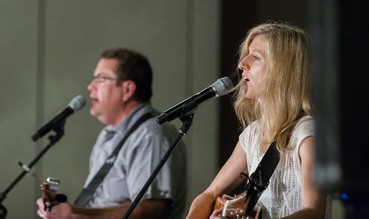Greg Ferrara, left, and Geneva Tigue, local musicians from south of Atlanta, lead worship for the REVIVE track at the 2016 Eucharistic Congress. Photo By Thomas Spink