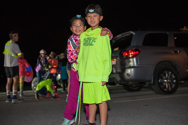 Hosted  by Travel with care NWA, runners gathered at Memorial Park in Bentonville adorned in lights from head to toe for a fun run promoting safety and awareness for drivers and pedestrians.