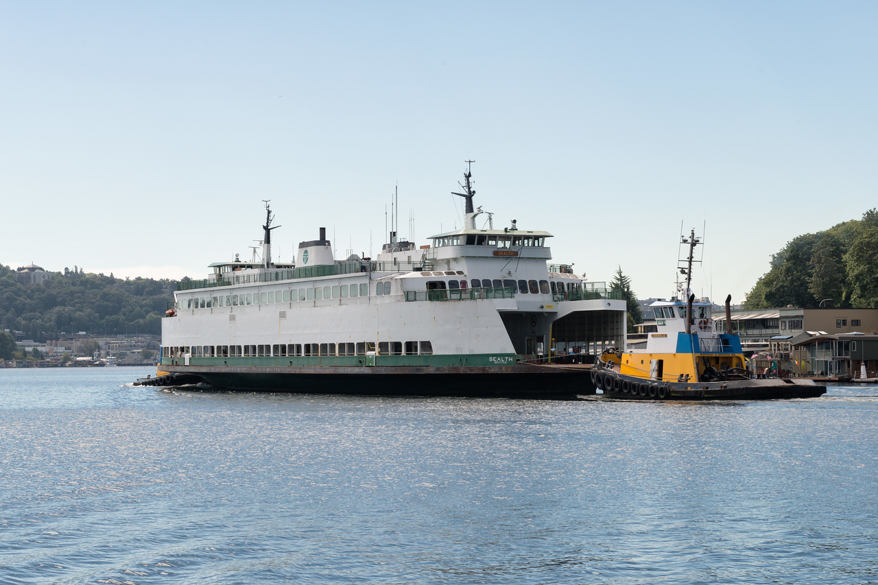 """20160725.  Ferry """"Sealth"""" being towed into Lake Union (Seattle WA).  The Sealth is heading to a Lake Union drydock for maintenance."""