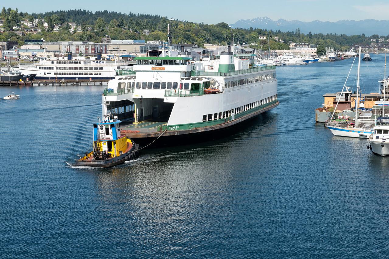 "20160725.  Ferry ""Sealth"" approaching Ballard Bridge from Salmon Bay in Ballard (Seattle WA).  The Sealth is heading to a Lake Union drydock for maintenance."