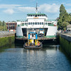 "20160725.  Ferry ""Sealth"" being towed through Hiram M. Chittenden Locks in Ballard (Seattle WA).  It barely fits in the lock.  The Sealth is heading to a Lake Union drydock for maintenance."