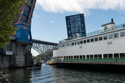 "20160725.  Ferry ""Sealth"" being towed through Fremont Bridge on Lake Washington Ship Canal.  The Sealth is heading to a Lake Union drydock for maintenance."