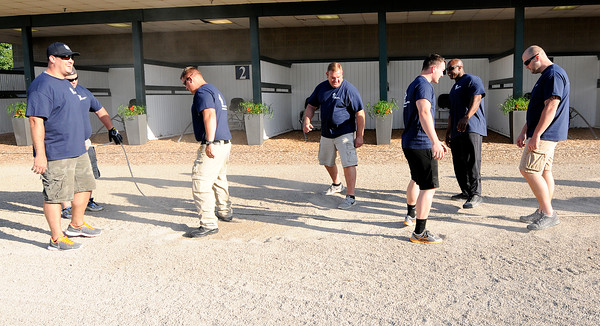 Don Knight   The Herald Bulletin<br /> Guns & Hoses competition between Madison County police and fire departments at Hoosier Park on Saturday.
