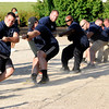 Don Knight | The Herald Bulletin<br /> The police officers win the tug-o-war during the Guns & Hoses competition between Madison County police and fire departments at Hoosier Park on Saturday.