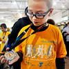 John P. Cleary | The Herald Bulletin<br /> Tyler Willhoite, 11, show off his medal after finishing the last mile of the St. Vincent-YMCA Kidz Marathon Saturday at Kardatzke Wellness Center.