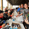 John P. Cleary | for The Herald Bulletin<br /> Driver Caleb Armstrong signs autographs for fans before the start of the 2016 Pay Less Little 500 sprint car race.