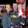 John P. Cleary | for The Herald Bulletin<br /> 2016 Pay Less Little 500 winner Kody Swanson with wife Jordan and son Trevor after the race.
