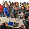 John P. Cleary | for The Herald Bulletin<br /> Fans line up the drivers autographs before the 2016 Pay Less Little 500 sprint car race.