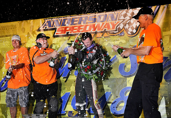John P. Cleary | for The Herald Bulletin<br /> 2016 Pay Less Little 500 winner Kody Swanson celebrates the victory with his crew.