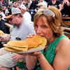 John P. Cleary | for The Herald Bulletin<br /> Shannon Joy, of Pendleton, enjoys her breaded tenderloins before the start of the 2016 Pay Less Little 500 sprint car race.