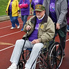 Cousins Judd Patterson; seated; and Eric Miller circle the track at Shenango High School during the survivors lap at Saturday's Relay for Life. The two also are veterans; with Patterson having served in Korea; and Miller in Vietnam.