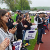 Friends; family members and other supporters line the track and applaud as cancer survivors pass them by in the opening lap of the Relay for Life.