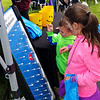 Adrianna Campoli, 7, and Giovanni DePaolo, 4, play a Plinko-type game at Relay.