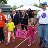 Representing McKesson, the Karns family holds hands as they walk in Saturday's Relay for Life. From left are mom Jodi, daughters Chellsie and Sydney and dad Scott.