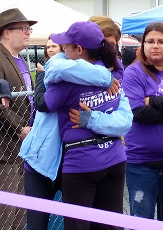 Jessica Stroia gets a hug from LuAnn Grybowski prior to cutting the ribbon to start Saturday's Relay of Life.