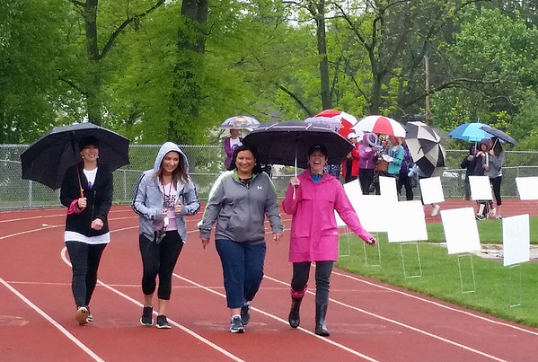Rain dampened the track, but not the spirits of the participants in Saturday's Relay for Life.
